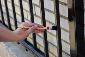 Brighton fence company - painting a fence