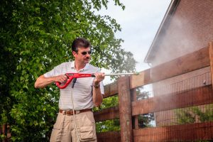 Thornton fence company pros suggest power washing maintenance